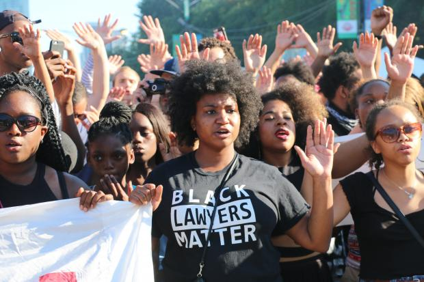 Activists marched against police brutality at the Taste of Chicago and along Michigan Avenue.