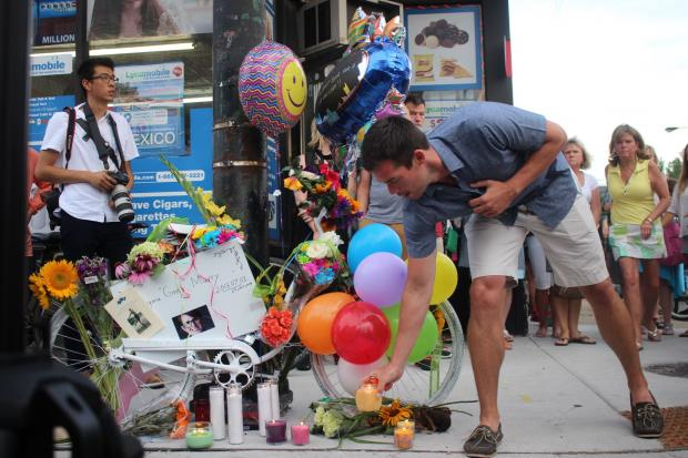 One week after Divvy rider Virginia Murray, 25, was killed in a crash at Belmont and Sacramento, mourners gathered to honor her memory with a ghost bike, which will remain at the intersection where she died.