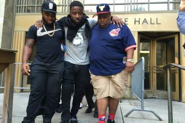 Troy Ave (center) leaves court free on $500,000 bail on July 11.