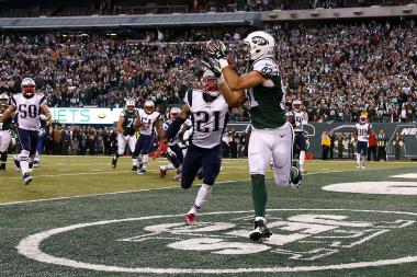 Eric Decker of the New York Jets scores the game winning touchdown in overtime against the New England Patriots in their game at MetLife Stadium on Dec. 27, 2015 in East Rutherford, New Jersey.