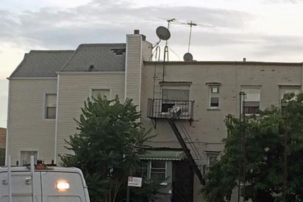 The suspect climbed down a fire escape on 78th Street before running into police on Stillwell Avenue on Monday, July 11, 2016.