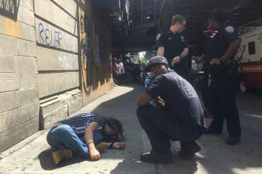 A person is slumped over on the sidewalk after sources said they took took K2 in Bedford-Stuyvesant on July 12, 2016, sources said.
