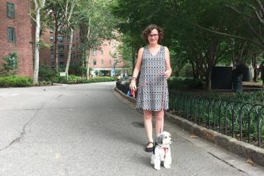 Julie Marshall stands near the Stuy Town Oval with her dog Georgie Girl.