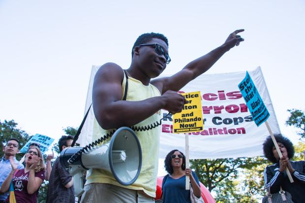 Activist Ja'Mal Green speaks to a crowd of activists outside the Taste of Chicago on July 9.
