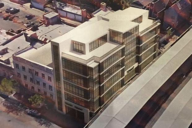 "Developers want to build a mixed-use building next to the Belmont ""L"" station."