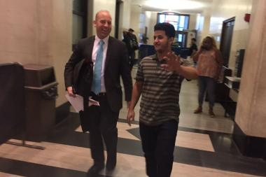 Yehyi Thabet giggled and tried to cover his face as he rushed out of Brooklyn Criminal Court together with his lawyer.