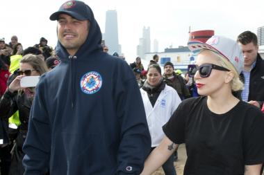 Lady Gaga and Taylor Kinney jump into icy Lake Michigan for charity.