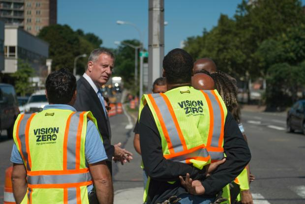 Mayor Bill de Blasio stands with some city workers redesigning Queens Boulevard according to Vision Zero plans on July 23, 2015.