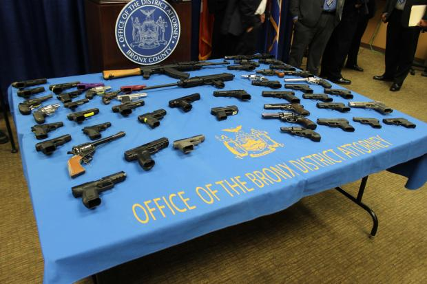 Officials say they have broken up gun trafficking rings that brought 50 guns into New York, including an assault rifle.
