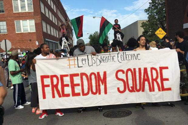Activists block the entrance to police facility Homan Square, 1011 S. Homan Ave., and rallied to demand divestment in police while funding predominantly black neighborhoods.