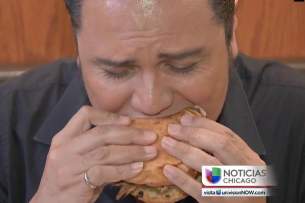 Host Aureliano Salgado bites into the jalapeno burger at Manzo's Burger in Morgan Park. The burger joint at 2353 W. 111th St. was highlighted for having the Best Burgers in Chicago, according to the restaurant's Facebook page.