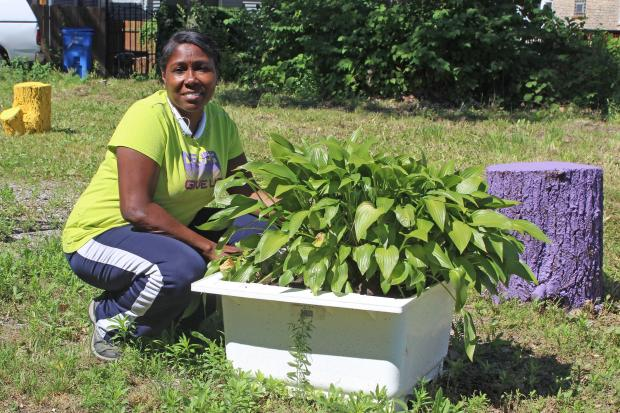 Vora Williams acquired a large lot through the City's $1 Large Lot Program and turned it into a garden.