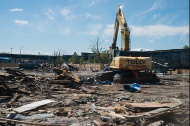 Construction crews were finishing demolition of a strip of former auto body shops in Willets Point to prepare for its multi-billion dollar renovation.