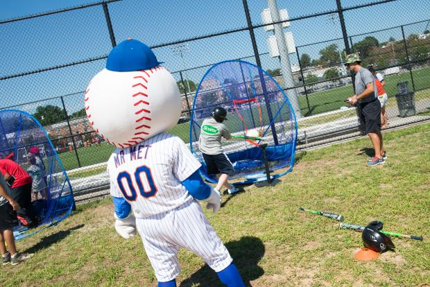 Mr. Met cheered on players from the College Point Little League as they took part in hitting and fielding drills at the newly-revamped Field # 4, which was fixed with help from the Mets and Scotts.