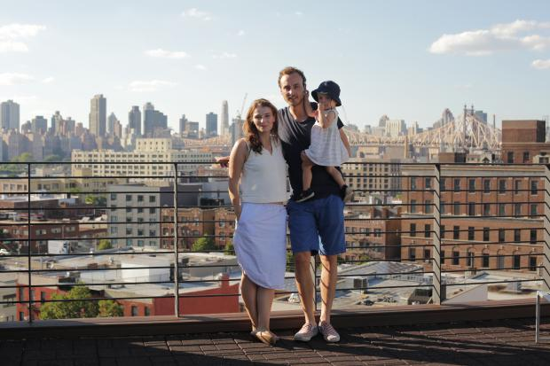 Christina Horsten, Felix Zeltner and baby Emma on the roof of their temporary home in Long Island City.