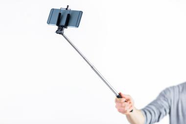 A teen beat a man with a selfie stick on a Downtown Brooklyn street, police said.