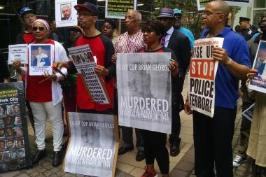 About two dozen protesters stood outside the Brooklyn DA's Office demanding progress in the investigation of the shooting death of Nicholas Heyward, Jr. by the NYPD in 1994.