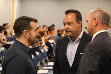 Martin Ritter of the Chicago Teachers Union talks with Ald. George Cardenas before Wednesday's Board of Education meeting.