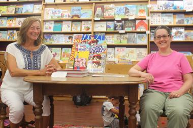 Linda Boubon, founder of Women and Children First Bookstore, and Lynn Mooney, the store's current owner.
