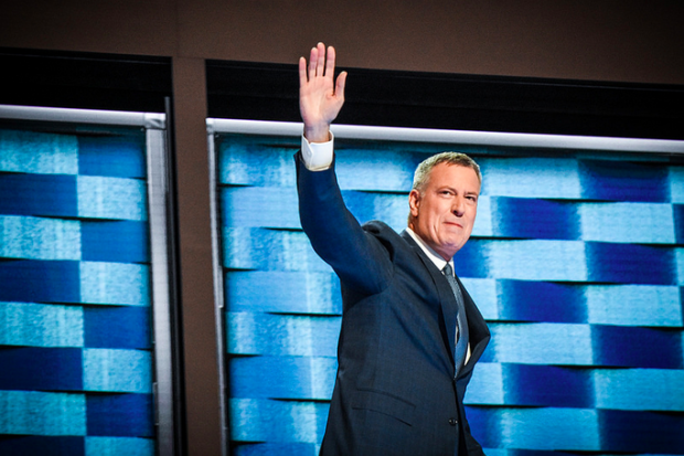 He didn't get a primetime speaking slot at the Democratic National Convention but that didn't stop Mayor Bill de Blasio from celebrating the nomination of his former boss Hillary Clinton as the first woman to head a major party presidential ticket.