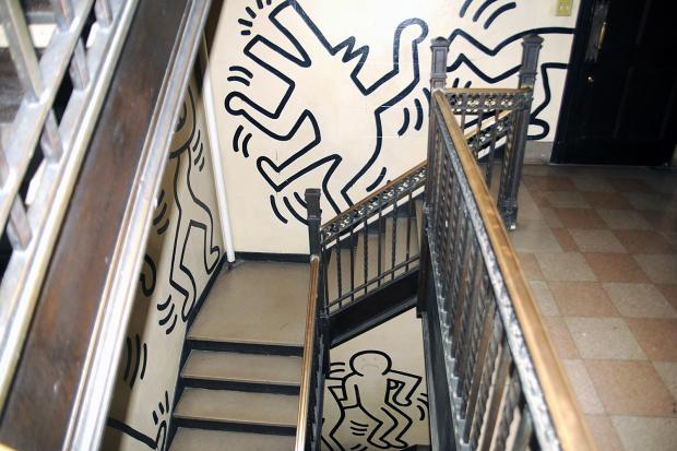 The Grace House, a residential building owned by the Church of the Ascension, is home to a three-floor mural by legendary New York City artist Keith Haring. But the Church has booted tenants due to costs cuts. The tenats fear that a sale of the building would imperil the mural.