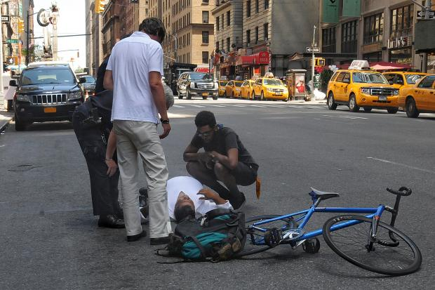 A cyclist slammed into a pedestrian crossing Seventh Avenue near 53rd Street in Midtown Wednesday afternoon, Aug. 3, 2016.