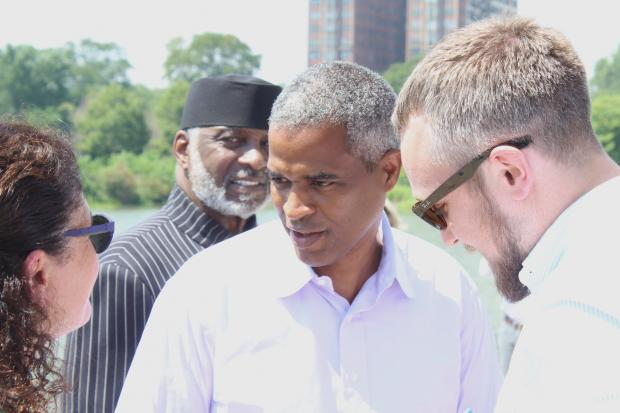 Marty Nesbitt (center), chairman of the Obama Foundation board, appears at Jackson Park Wednesday to explain why the Obama Presidential Library will be built there.