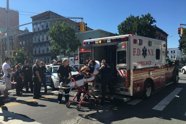 A police officer was put on a stretcher and taken into an ambulance after a crash in Williamsburg.