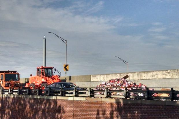 Commuters should expect extensive delays in the area after cans covered the highway, the NYPD  said.