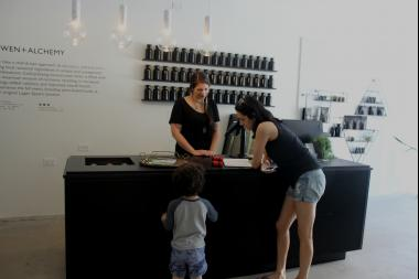 Owen + Alchemy employee Niki Rosario helping customers on a recent afternoon.