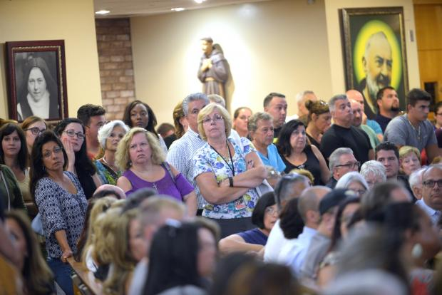 St. Helen's Church was filled with people who had questions about the investigation into Karina Vetrano's murder as well as fears for their own safety.