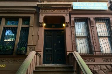 The Central Harlem brownstone that residents say they have seen raccoons congregate in the backyard area.