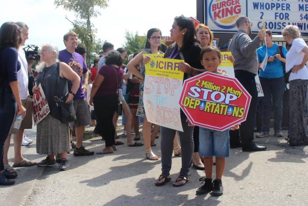 After immigration officers detained three day laborers, Ald. Carlos Ramirez-Rosa (35th) joined activists in protesting recent actions of the Immigration and Customs Enforcement agents