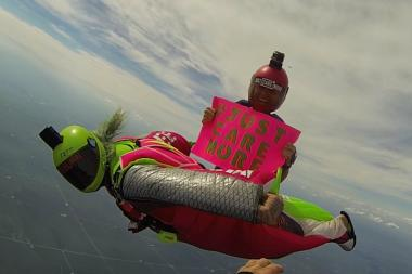 Jamie Leibert (bottom) is in Chicago this week as part of his charity, Just Care More, which promotes extreme sports as an alternative to drugs and gangs for children. Here he skydives with his girlfriend and charity partner, Sandra Zinovyev.