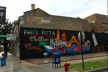 The new paint job at Phil's Pizza is coming along nicely.