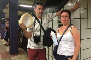 Karim Bouffay fanned his wife Virginia with a fedora as they waited on the 42nd Street uptown A/C/E platform, which felt like 107.5 degrees.