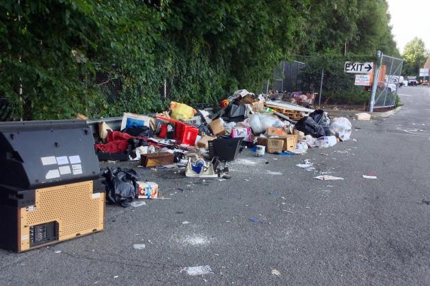 The parking lot of a recently closed Sports Authority in Forest Hills has turned into a dumping ground, locals say.