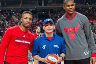 Abner Garcia (c.) was shot dead Saturday in West Elsdon. The photo shows Garcia being honored for his work with the YMCA at a recent bulls game. He is pictured with Trail Blazers star Damian Lillard and Bulls center Cristiano Felicio.