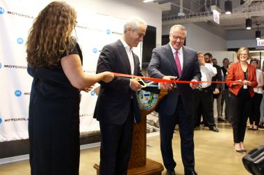Mayor Rahm Emanuel and Motorola Solutions CEO Greg Brown prepare to cut the ribbon opening the firm's new Downtown headquarters.