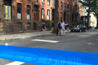 Investigators taped off Sixth Avenue between Prospect Place and Flatbush Avenue as they investigated the shooting.