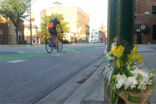 A 21-year-old woman who was riding her bike was hit by a semi-truck and killed Tuesday morning, police said.