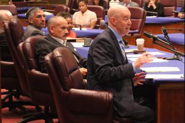 University of Chicago law professor Craig Futterman testifies before the Police Accountability Subcommittee as Aldermen Ricardo Munoz (left) and Ariel Reboyras look on.