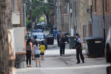 Police responding to a call of a man threatening neighbors in Rogers Park last summer.