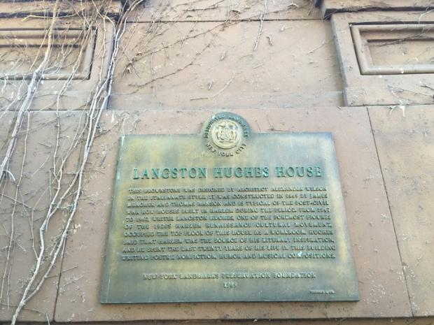 A plaque outside Langston Hughes' house, the one thing noting its historic nature.