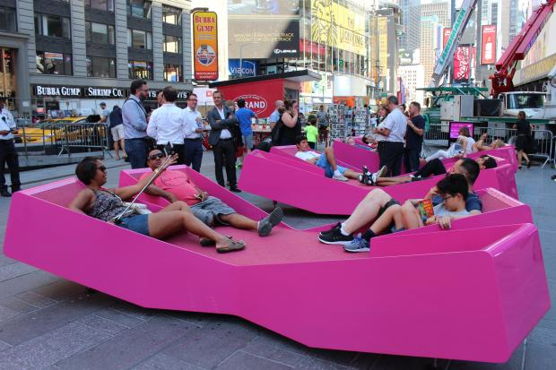 Three X-shaped chairs have been installed on a pedestrian plaza between West 43rd and West 44th streets.