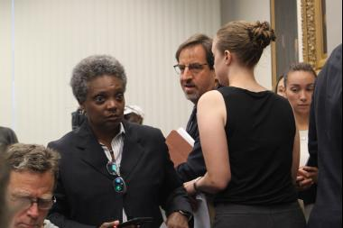 Lori LIghtfoot prepares to testify before the City Council's Public Safety Subcommittee. Adam Gross is at right.