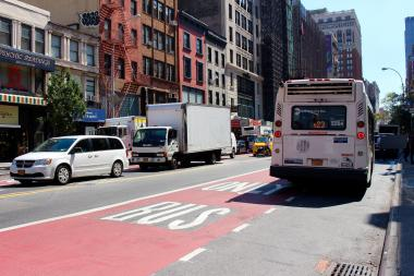 One of the new M23 Select Bus Service lanes on West 23rd Street, between Sixth and Seventh avenues. DOT on Monday will begin ticketing scofflaw motorists who drive in the bus lanes.
