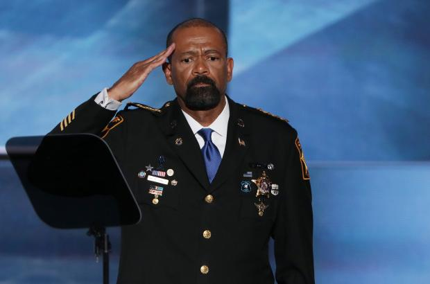 Milwaukee County Sheriff David Clarke salutes the crowd prior to delivering a speech on the first day of the Republican National Convention on July 18, 2016 at the Quicken Loans Arena in Cleveland, Ohio.