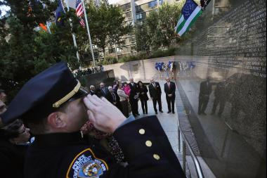 Mayor Michael Bloomberg (R) and New York City Police Commissioner Ray Kelly (C) stand among family members of officers who died in the line of duty during an unveiling ceremony at the New York City Police Memorial Wall on October 11, 2012. This year, police officers and loved ones of people who were killed on 9/11 or succumbed to illness in the years following, will march to the memorial for a ceremony on Friday., Sept. 9.