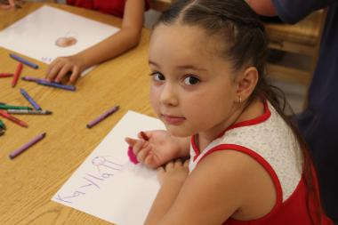 Kindergarten and pre-kindergarten students drew pictures of the mayor to celebrate his visit to their new classroom.